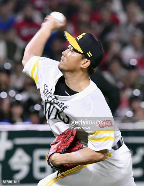 SoftBank Hawks pitcher Daisuke Matsuzaka starts in a preseason match at Yafuoku Dome in the southwestern Japan city of Fukuoka on March 25 throwing...