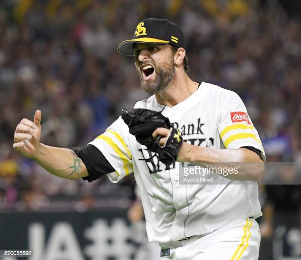 SoftBank Hawks pitcher Dennis Sarfate reacts after getting out of a jam in the 10th inning against the DeNA BayStars in Game 6 of the Japan Series at...