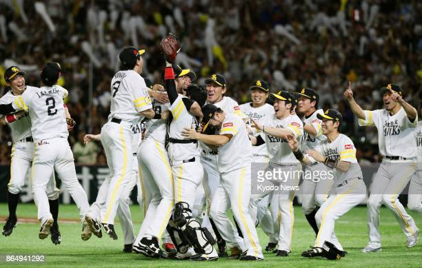 SoftBank Hawks players celebrate after a 70 victory over the Rakuten Eagles in a Pacific League Climax Series final stage game at Yafuoku Dome in...