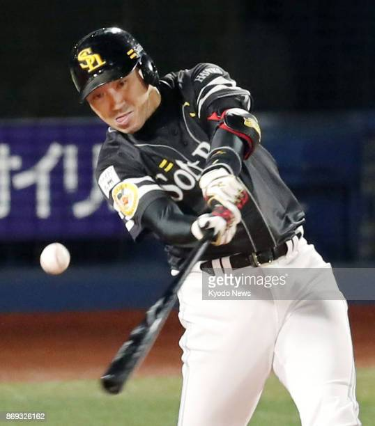 SoftBank Hawks' Seiichi Uchikawa hits an RBI double off DeNA BayStars starting pitcher Kenta Ishida in the first inning of Game 5 of the Japan Series...