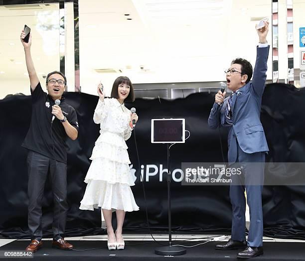 SoftBank President Ken Miyauchi actress Suzu Hirose and tv presenter Ichiro Furudachi attend the iPhone 7 launch event on September 16 2016 in Tokyo...