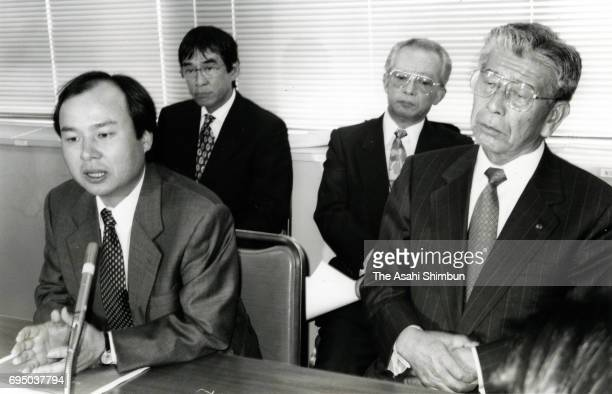 SoftBank President Masayoshi Son and Dentsu President Yutaka Narita attend a press conference announcing they are setting up an internet advert...