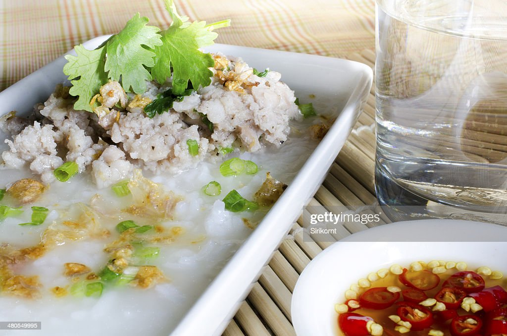soft-boiled rice pork with Glass of water and fish sauce : Stock Photo