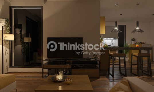 Softly Illuminated Lounge and the Kitchen : Stock Photo