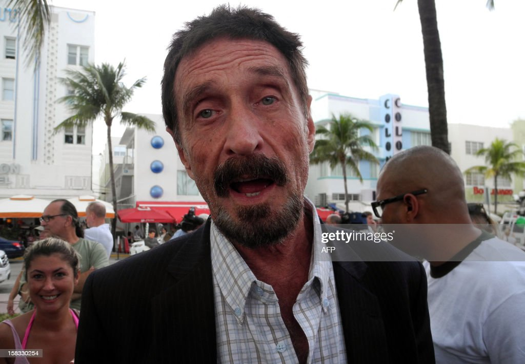 Software company founder John McAfee talks to AFP in front of this hotel in Miami Beach, Florida on December 13, 2012, a day after being deported to US from Guatemala, where was detained last week for immigration violations. Anti-virus software pioneer John McAfee was back on American soil Wednesday after being expelled from Guatemala, escaping immediate deportation to Belize for questioning over his neighbor's murder. AFP PHOTO/PAULA BUSTAMANTE