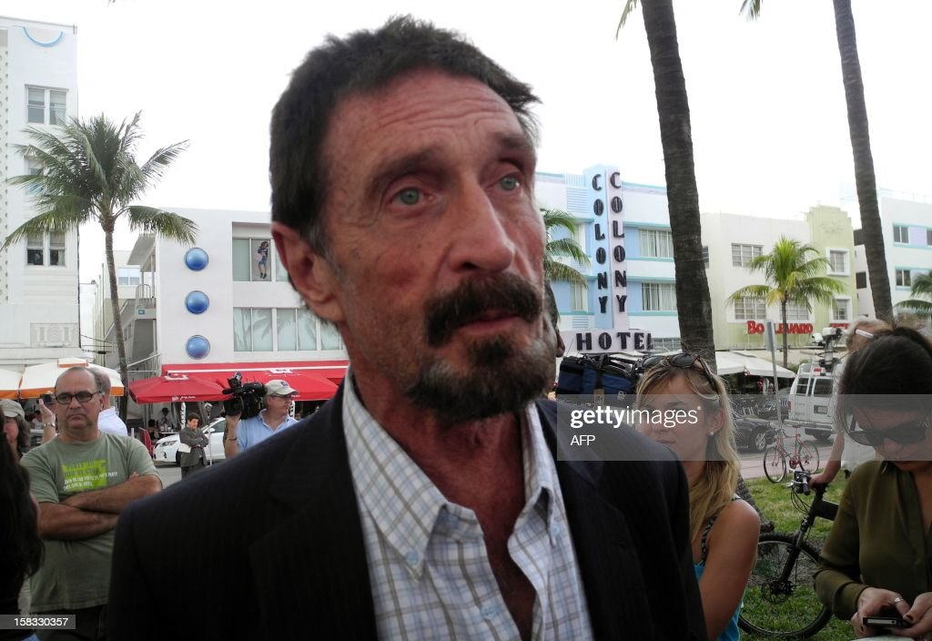 Software company founder <a gi-track='captionPersonalityLinkClicked' href=/galleries/search?phrase=John+McAfee&family=editorial&specificpeople=1353446 ng-click='$event.stopPropagation()'>John McAfee</a> talks to AFP in front of this hotel in Miami Beach, Florida on December 13, 2012, a day after being deported to US from Guatemala, where was detained last week for immigration violations. Anti-virus software pioneer <a gi-track='captionPersonalityLinkClicked' href=/galleries/search?phrase=John+McAfee&family=editorial&specificpeople=1353446 ng-click='$event.stopPropagation()'>John McAfee</a> was back on American soil Wednesday after being expelled from Guatemala, escaping immediate deportation to Belize for questioning over his neighbor's murder. AFP PHOTO/PAULA BUSTAMANTE