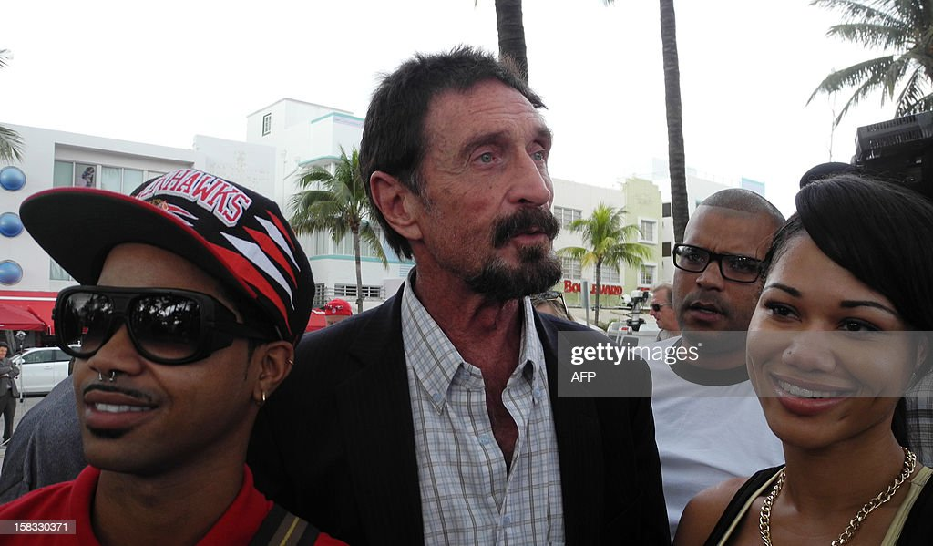 Software company founder <a gi-track='captionPersonalityLinkClicked' href=/galleries/search?phrase=John+McAfee&family=editorial&specificpeople=1353446 ng-click='$event.stopPropagation()'>John McAfee</a>(C) talks to AFP in front of this hotel in Miami Beach, Florida on December 13, 2012, a day after being deported to US from Guatemala, where was detained last week for immigration violations. Anti-virus software pioneer <a gi-track='captionPersonalityLinkClicked' href=/galleries/search?phrase=John+McAfee&family=editorial&specificpeople=1353446 ng-click='$event.stopPropagation()'>John McAfee</a> was back on American soil Wednesday after being expelled from Guatemala, escaping immediate deportation to Belize for questioning over his neighbor's murder. AFP PHOTO/PAULA BUSTAMANTE