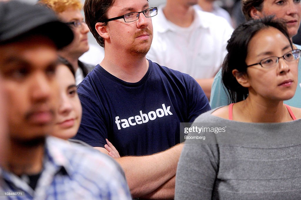 Software designer Chad Little and other employees attend the launch of the Places feature at the headquarters of Facebook Inc. in Palo Alto, California, U.S., on Wednesday, Aug. 18, 2010. Facebook Inc. unveiled a service that makes it easier for users to share their whereabouts with other people, making a deeper push into a fast-growing market pioneered by Foursquare Labs Inc. Photographer: Noah Berger/Bloomberg via Getty Images