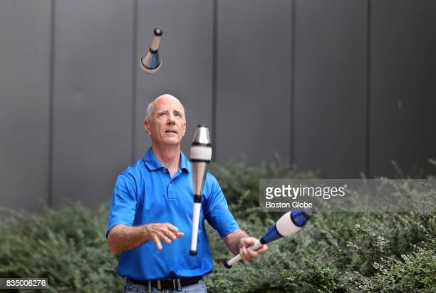 Software engineer Greg Mangan finds a windfree alcove outside the John Joseph Moakley United States Courthouse in Boston to practice his daily...