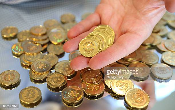 Software engineer Mike Caldwell holds physical Bitcoins he minted in his shop on April 26 2013 in Sandy Utah Bitcoin is an experimental digital...