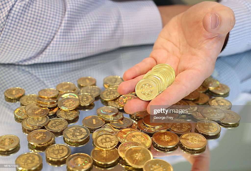 Software engineer Mike Caldwell holds physical Bitcoins he minted in his shop on April 26, 2013 in Sandy, Utah. Bitcoin is an experimental digital currency used over the Internet that is gaining in popularity worldwide.