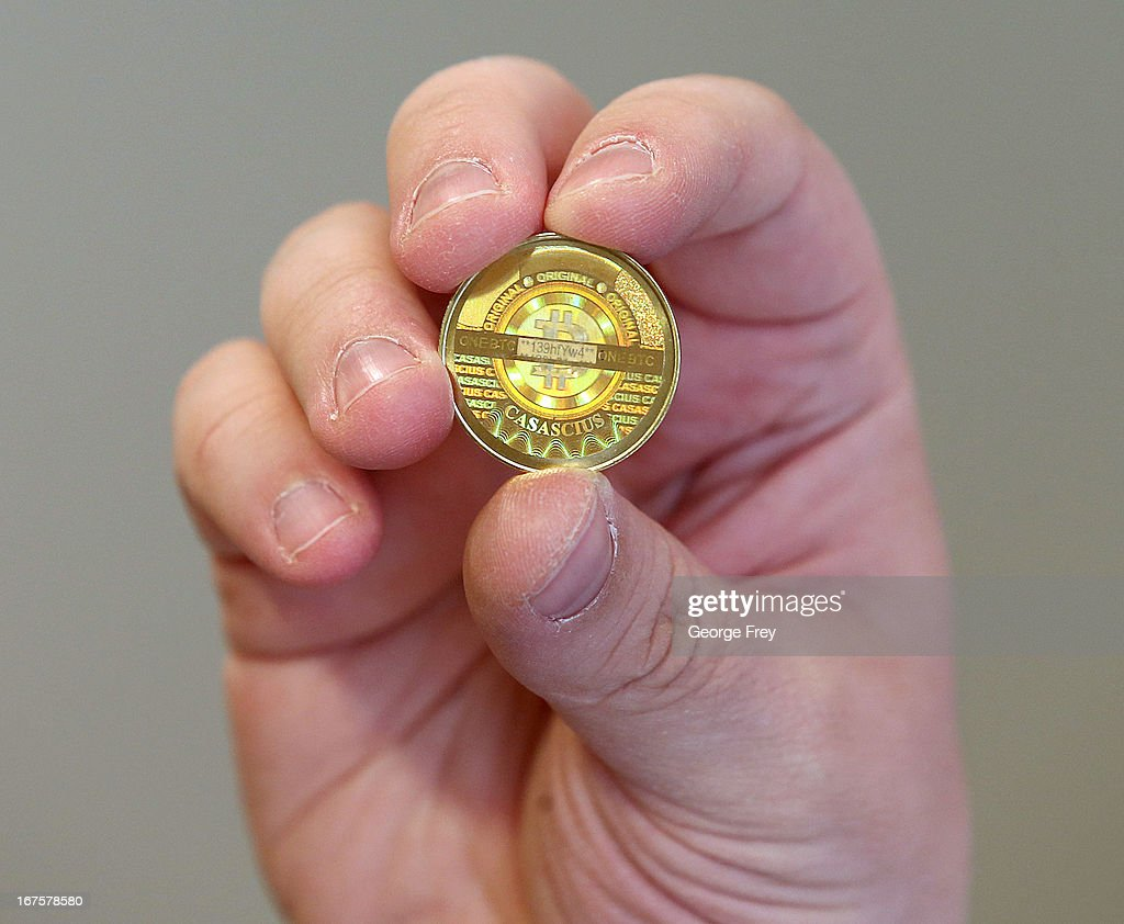 Software engineer Mike Caldwell shows the back, hologram side, of a physical Bitcoin he minted in his shop on April 26, 2013 in Sandy, Utah. Bitcoin is an experimental digital currency used over the Internet that is gaining in popularity worldwide.
