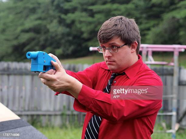 Software engineer Travis Lerol takes aim with an unloaded Liberator handgun in the backyard of his home on July 11 2013 The Liberator is the first...