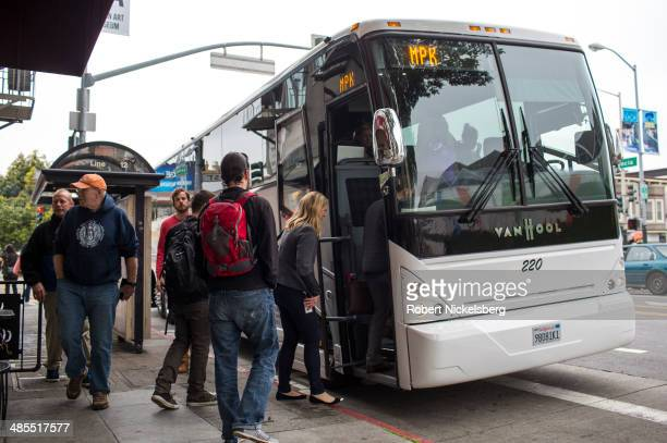 Software engineers designers and IT employees of technology companies board shuttle buses to Silicon Valley April 14 2014 in the Mission District of...