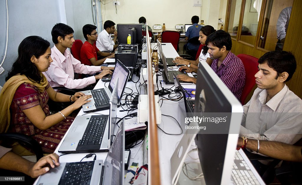 Software programmers work on computers as they develop applications at the MoFirst Solutions Pvt office in Mumbai India on Saturday Aug 20 2011...