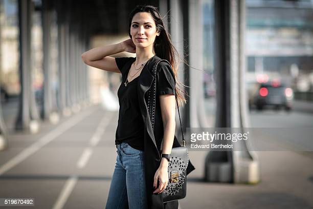 Sofya Benzakour is wearing a New look black jacket a New Look black top Berenice blue jeans Primark black boots and a Furla black bag during a street...