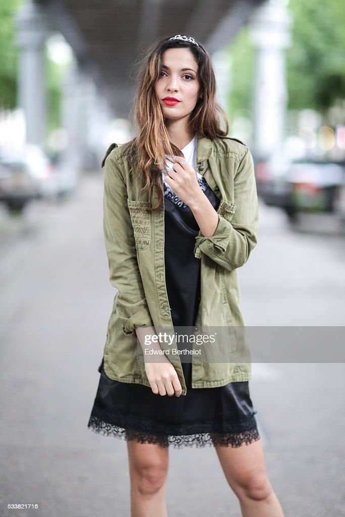 Sofya Benzakour (La couleur du moment), is wearing an Asos black dress, an Asos white t-shirt, a Zara green jacket, and Mi-Mai black boots, during a street style session, on May 23, 2016 in Paris, .
