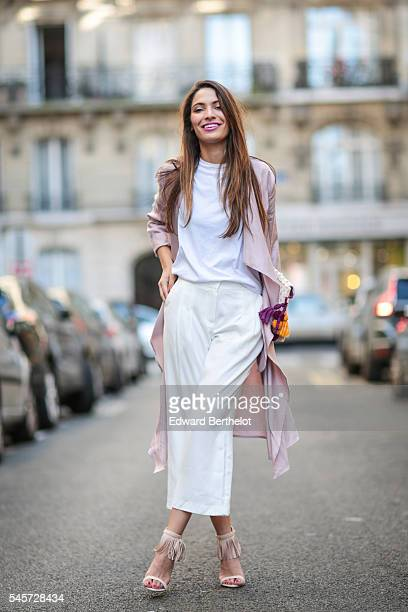 Sofya Benzakour is wearing an Asos top a 3 Suisses trench coat Next pants and 3 Suisses heels shoes during a street style session on July 9 2016 in...