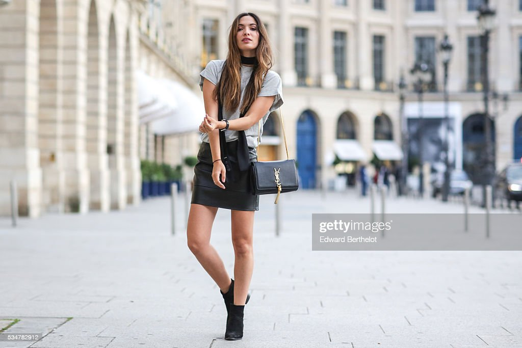 Sofya Benzakour (fashion blogger - La couleur du moment), is wearing Asos black shoes, an Asos black skirt, an Asos white top, and a Saint Laurent YSL black bag, during a street style session, on May 27, 2016 in Paris.