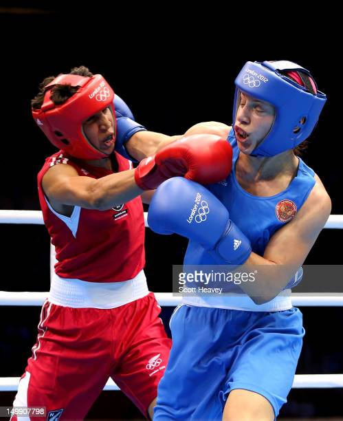 Sofya Ochigava of Russia competes against Alexis Pritchard of New Zealand during the Women's Light Boxing Quarterfinals on Day 10 of the London 2012...