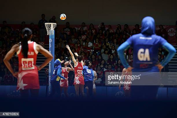 Soh Shi Hui Charmine of Singapore shoots at goal during the women's netball gold medal match between Singapore and Malaysia at the OCBC Arena Hall...