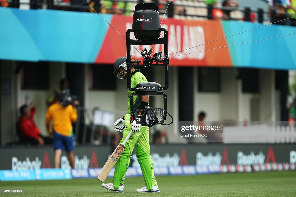 Sohaib Maqsood of Pakistan is followed by Spidercam as he walks off the field after being caught out during the 2015 ICC Cricket World Cup match...