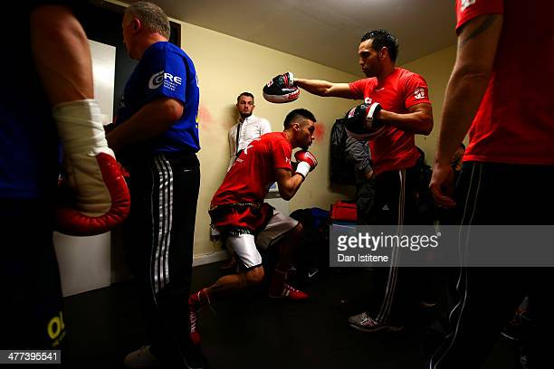Sohail Ahmad prepares with his trainer in the changing rooms before his Light Welterweight bout against Ivans Levickis at York Hall on March 8 2014...