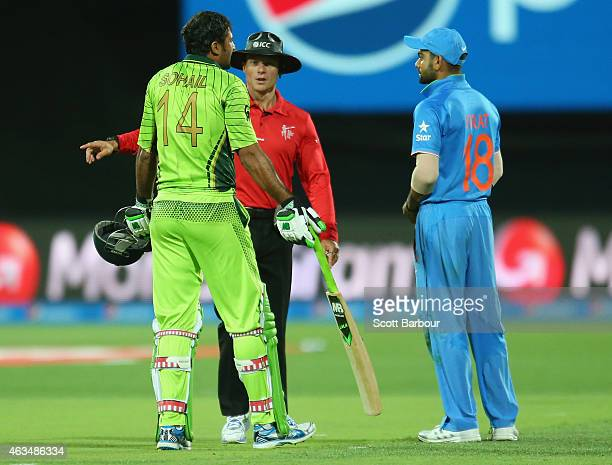 Sohail Khan of Pakistan and Virat Kohli of India exchange words on the field during the 2015 ICC Cricket World Cup match between India and Pakistan...
