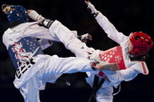 SoHe Kim of Korea competes with AnnaLena Froemming of Germany during the women's 57 kg semifinal combat of WTF World Taekwondo Championships 2013 at...
