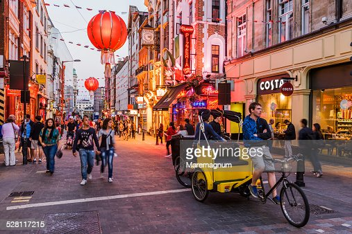 Soho, Chinatown, rickshaw in Wardour street