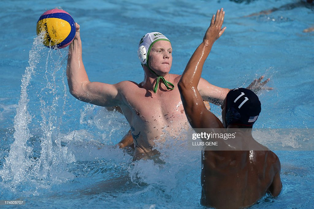 Sohth Africa's Etienne Ie Roux (L) vies with US player Timothy Hutten (R) during the preliminary round match of the men's water polo competition between the US and South Africa at the FINA World Championships at the Bernat Picornell swimming pool in Barcelona on July 24, 2013.