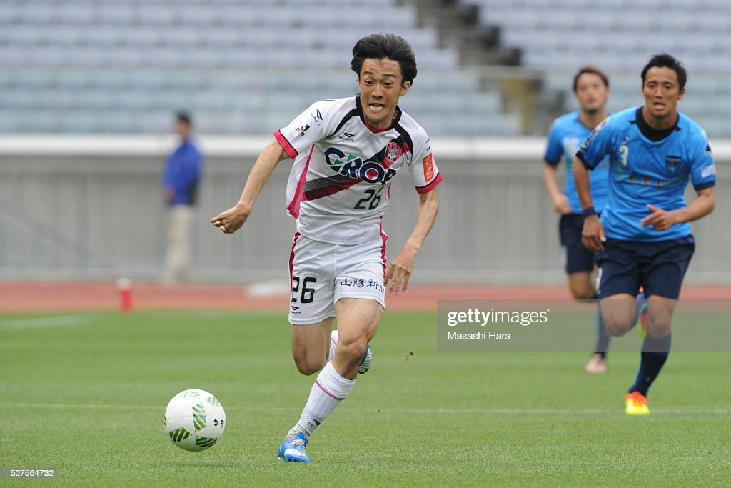 Soichi Tanaka #26 of Fagiano Okayama in action during the J.League second division match between Yokohama FC and Fagiano Okayama at the Nissan Stadium on May 3, 2016 in Yokohama, Kanagawa, Japan.