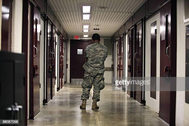 A US soilder stands inside a hallway at Camp 5 detention facility on May 31 2009 at US Naval Base Guantanamo Bay Cuba Camp six is a mediumsecurity...