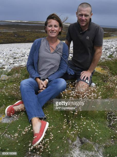 Soizic and David Cuisnier pose on August 9 2017 in the island of Quemenes in Le Conquet western France A family rehabilated a breeding and ecological...