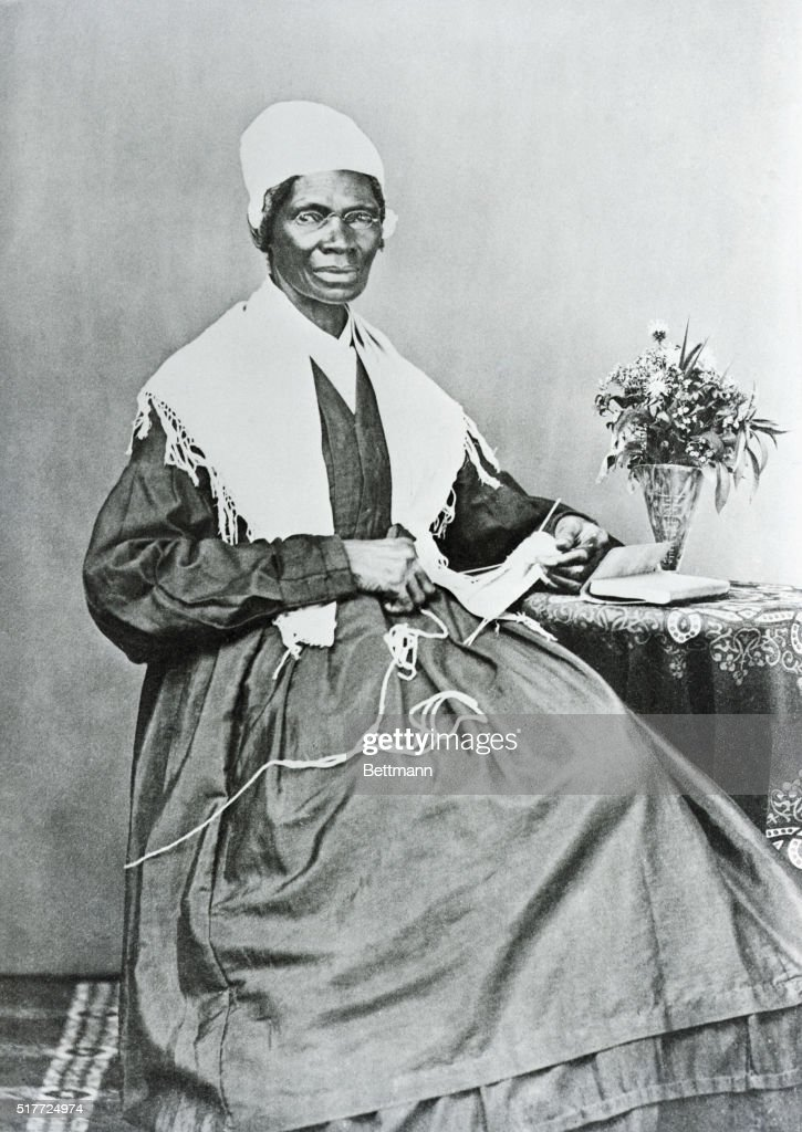 Sojourner Truth poses for a portrait while knitting at a small table. Sojourner Truth, whose legal name was Isabella Van Wagener, was born into slavery but later freed. She worked as an abolitionist, a suffragette, and an evangelist and traveled throughout the Midwest drawing large crowds. She supported herself by selling copies of her book, The Narrative of Sojourner Truth.
