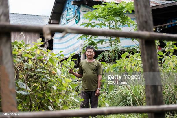 Sok Veanis a farmer who has lived in Krabei Chrun village since 1979 is pictured outside is home During the inital impact assement Krabei Churn...