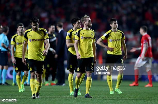 Sokratis and Andre Schuerrle of Dortmund look dejected after the UEFA Champions League Round of 16 first leg match between SL Benfica and Borussia...