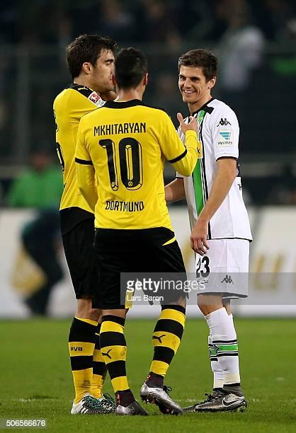 Sokratis and Henrikh Mkhitayan of Dortmund are seen with Jonas Hofmann of Moenchengladbach after the Bundesliga match between Borussia...