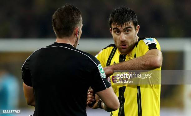 Sokratis discusses with referee Tobias Stieler during the Bundesliga match between Borussia Dortmund and RB Leipzig at Signal Iduna Park on February...