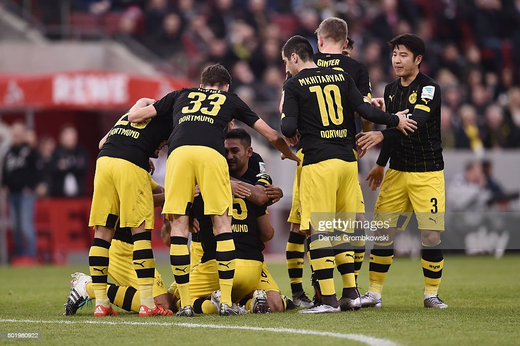 Sokratis of Borussia Dortmund celebrates with team mates as he scores the opening goal during the Bundesliga match between 1. FC Koeln and Borussia Dortmund at RheinEnergieStadion on December 19, 2015 in Cologne, Germany.