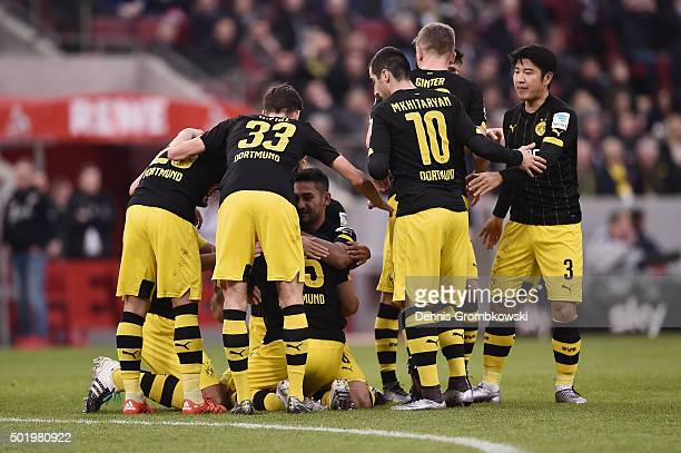 Sokratis of Borussia Dortmund celebrates with team mates as he scores the opening goal during the Bundesliga match between 1 FC Koeln and Borussia...
