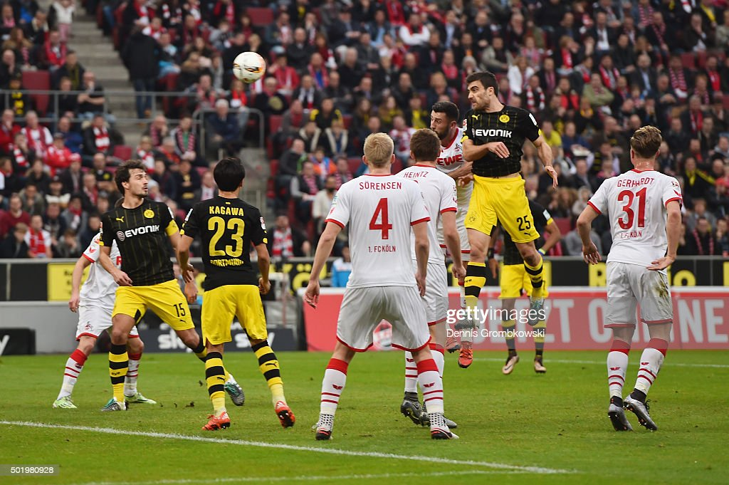 Sokratis of Borussia Dortmund heads the opening goal during the Bundesliga match between 1. FC Koeln and Borussia Dortmund at RheinEnergieStadion on December 19, 2015 in Cologne, Germany.