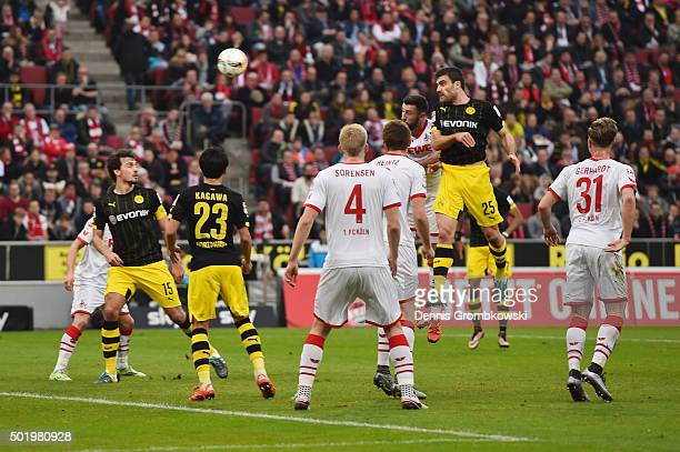 Sokratis of Borussia Dortmund heads the opening goal during the Bundesliga match between 1 FC Koeln and Borussia Dortmund at RheinEnergieStadion on...