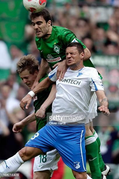 Sokratis of Bremen and Sejad Salihovic of Hoffenheim battle for the ball during the Bundesliga match between SV Werder Bremen and TSG 1899 Hoffenheim...