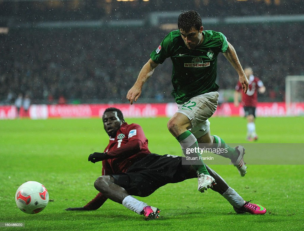 Sokratis of Bremen challenges for the ball with Mame Diouf of Hannover during the Bundesliga match between SV Werder Bremen and Hannover 96 at Weser Stadium on February 1, 2013 in Bremen, Germany.