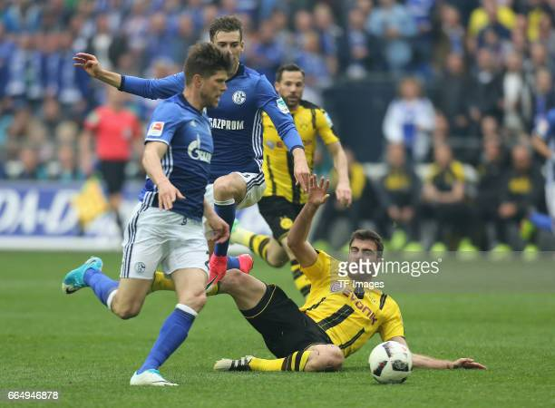 Sokratis of Dortmund and KlaasJan Huntelaar of Schalke battle for the ball during the Bundesliga match between FC Schalke 04 and Borussia Dortmund at...