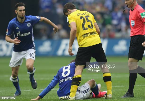 Sokratis of Dortmund and Leon Goretzka of Schalke in action during the Bundesliga match between FC Schalke 04 and Borussia Dortmund at VeltinsArena...
