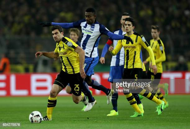 Sokratis of Dortmund and Salomon Kalou of Berlin battle for the ball during the DFB Cup Round of 16 match between Borussia Dortmund and Hertha BSC at...