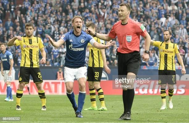 Sokratis of Dortmund Benedikt Hoewedes of Schalke Felix Zwayer looks on during the Bundesliga match between FC Schalke 04 and Borussia Dortmund at...