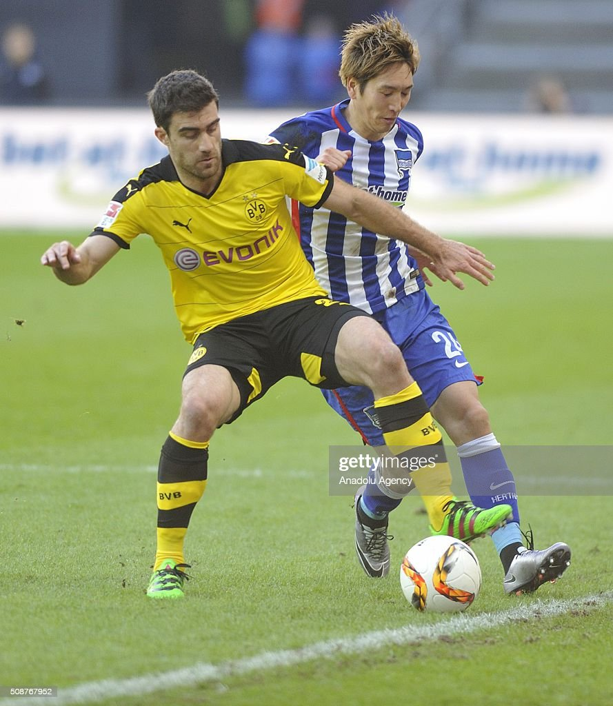 Sokratis of Dortmund in action against Haraguchi (R) of Berlin during the Bundesliga match between Hertha BSC and Borussia Dortmund at Olympiastadion on February 6, 2016 in Berlin, Germany.